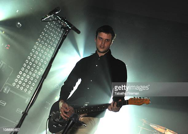 Harry McVeigh of White Lies performs on stage at The Corn Exchange on February 7 2011 in Brighton England