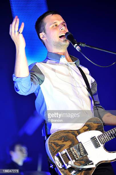 Harry McVeigh of White Lies performs on stage at Wembley Arena on December 17 2011 in London United Kingdom