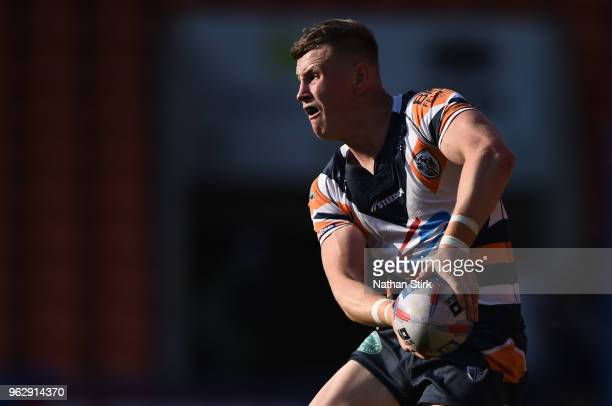 Harry Newman of Featherstone and William Sharp of Halifax in action during the Rugby League 2018 Summer Bash match between Halifax and Featherstone...
