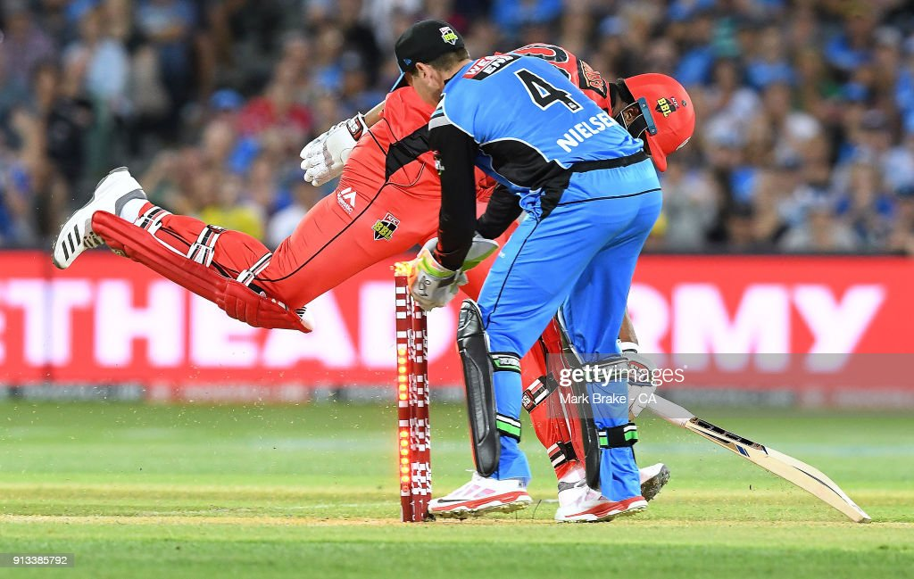 Harry Nielsen of the Adelaide Strikers takes the bails as Kieron Pollard of the Melbourne Renegades makes his crease during the Big Bash League match between the Adelaide Strikers and the Melbourne Renegades at Adelaide Oval on February 2, 2018 in Adelaide, Australia.
