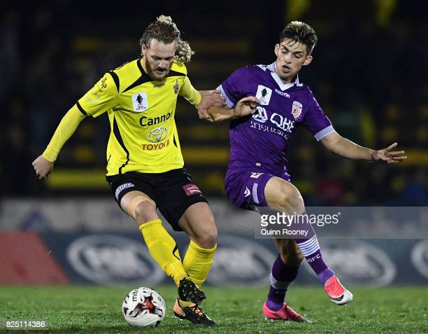 Harry Noon of United and Brandon Wilson of Glory compete for the ball during the FFA Cup round of 32 match between Heidelberg United FC and Perth...