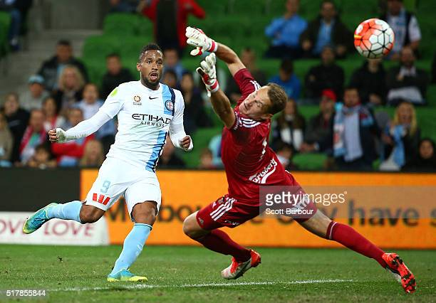 Harry Novillo of City FC beats goalkeeper Glen Moss of the Phoenix to score the first goal during the round 25 ALeague match between Melbourne City...