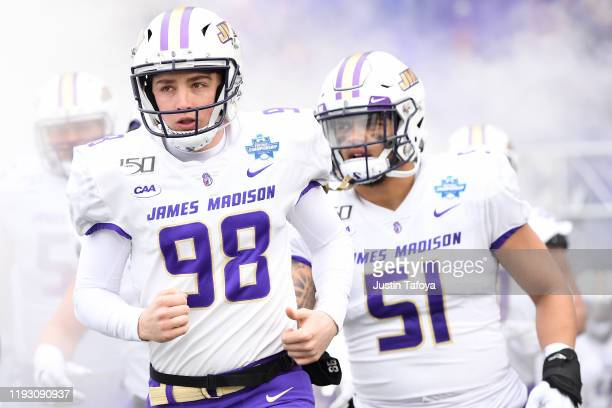 Harry O'Kelly of the James Madison Dukes takes the field against the North Dakota State Bison during the Division I FCS Football Championship held at...
