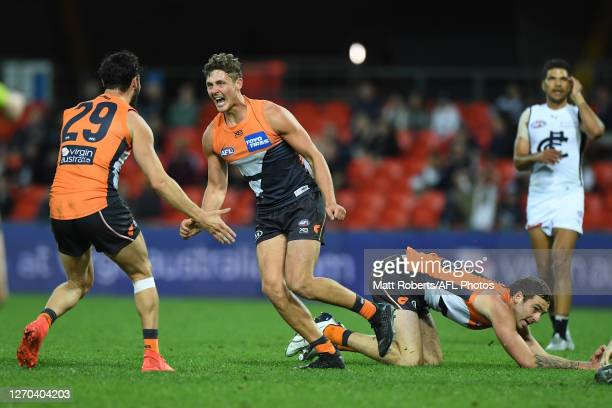 Harry Perryman of the Giants celebrates kicking a goal during the round 15 AFL match between the Greater Western Sydney Giants and the Carlton Blues...