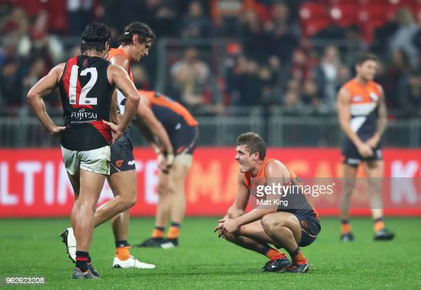 Harry Perryman of the Giants looks dejected at fulltime during the round 10 AFL match between the Greater Western Sydney Giants and the Essendon...