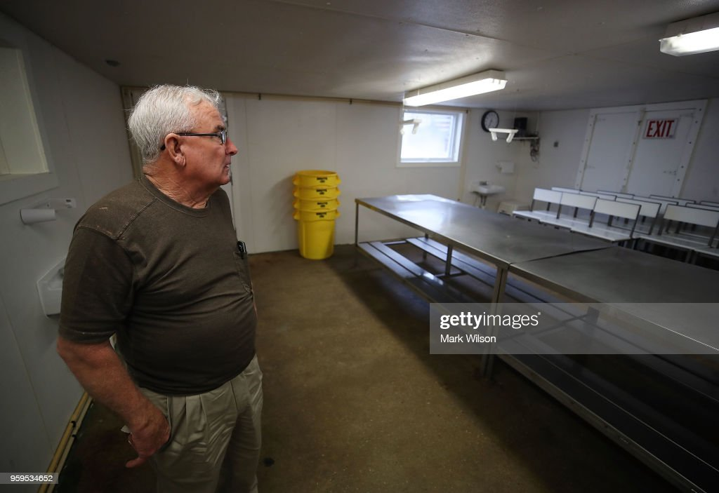 Harry Phillips of Russell Hall Seafood Co. stands in his empty crab picking room, on May 17, 2018 in Fishing Creek, Maryland. Due to a new lottery system this year, Russell Hall Seafood failed to get temporary H-2B visas for their mostly Mexican workforce that has been coming to the Maryland eastern shore for over two decades to pick the crab meat that is sold in restaurants and stores on the east coast.
