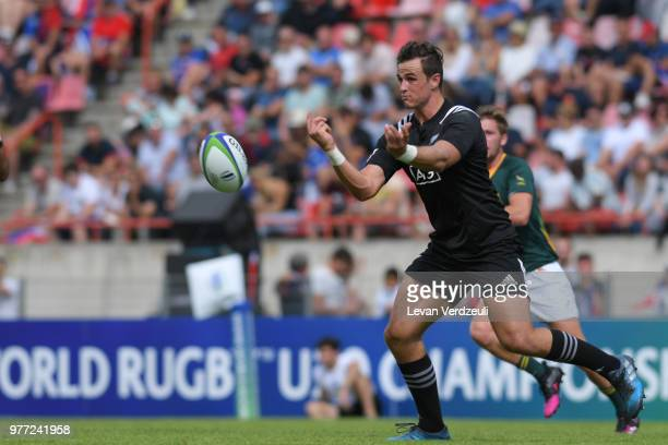 Harry Plummer of New Zealand passes the ball during World Rugby Under 20 Championship 3rd Place Play 0ff between South Africa and New Zealand on June...