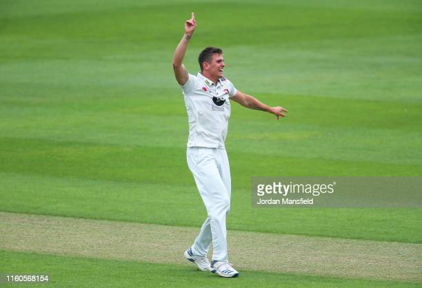 Harry Podmore of Kent celebrates dismissing Mark Stoneman of Surrey during day one the Specsavers County Championship Division 1 match between Surrey...