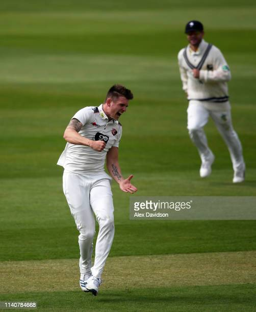 Harry Podmore of Kent celebrates taking the wicket of Marcus Trescothick during Day 2 of the Specsavers County Championship match between Somerset...
