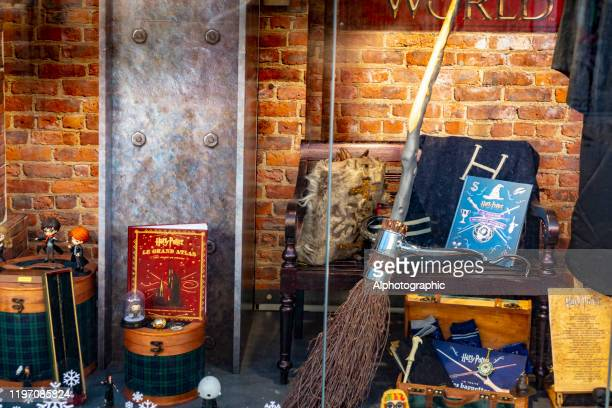 2019 harry potter display in paris bookshop window - harry potter and the deathly hallows book stock pictures, royalty-free photos & images