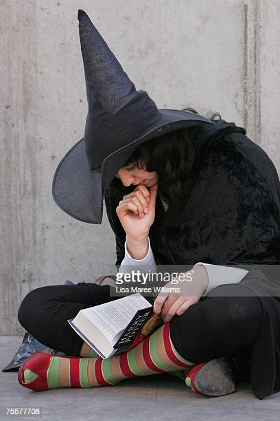 Harry Potter fan rushes to read the opening lines of the new and final novel by author JK Rowling 'Harry Potter and the Deathly Hallows' during a...