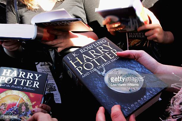 Harry Potter fans collect the final novel by author JK Rowling Harry Potter and the Deathly Hallows at the much anticipated launch on July 21 2007 at...