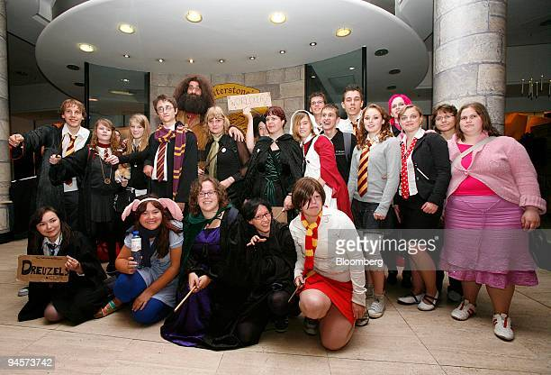 Harry Potter fans dressed up as characters from the book series pose inside a Waterstones Bookstore in Picadilly before buying the last book Harry...