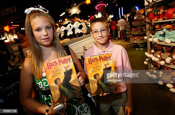 Harry Potter fans hold the new Harry Potter and the Deathly Hallows at Toys R Us Times Square on July 20 2007 in New York City