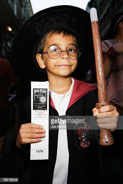 Harry Potter fans holding their preorder tickets at the 'Harry Potter Place' in celebration of the release of the 'Harry Potter and the Deathly...