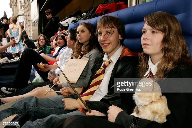 Harry Potter fans who arrived at 2pm yesterday Stephanie and Roy from the Netherlands queue outside Waterstones bookshop in Piccadilly awaiting the...