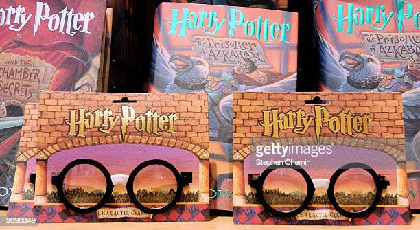 Harry Potter glasses are displayed along with already released books from the Potter series at the Scholastic store June 17 2003 in New York NY...