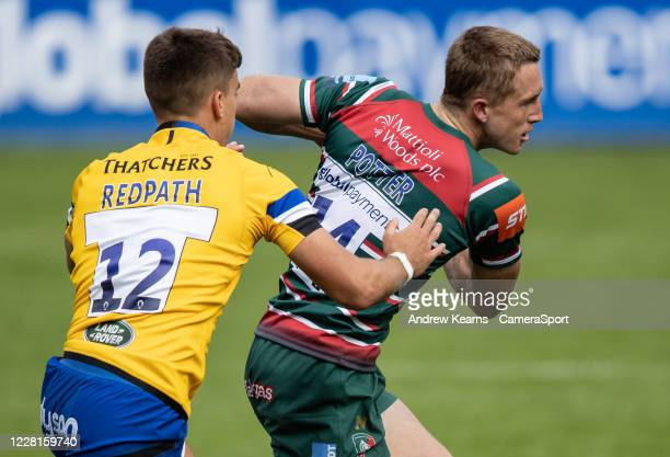 Harry Potter of Leicester Tigers breaks away from Cameron Redpath of Bath Rugby during the Gallagher Premiership Rugby match between Leicester Tigers...