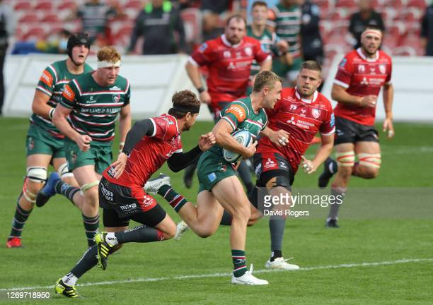 Harry Potter of Leicester Tigers breaks clear to score a try during the Gallagher Premiership Rugby match between Gloucester Rugby and Leicester...