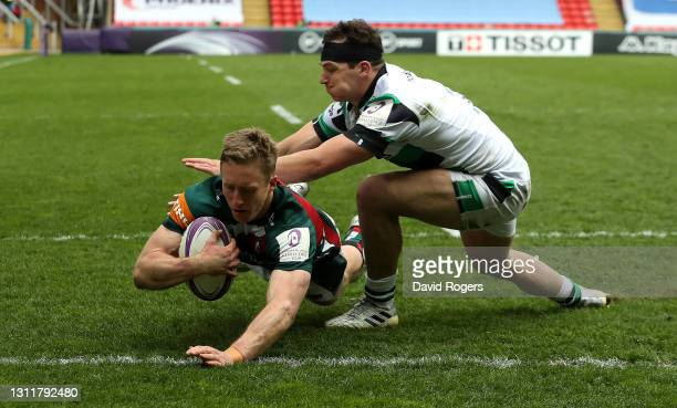 Harry Potter of Leicester Tigers dives over to score a late try despite being tackled challenged by Pete Lucock during the European Rugby Challenge...