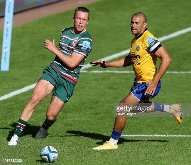Harry Potter of Leicester Tigers kicks the ball past Jonathan Joseph during the Gallagher Premiership Rugby match between Leicester Tigers and Bath...
