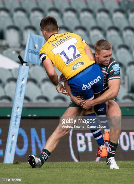 Harry Potter of Leicester Tigers tackles Cameron Redpath of Bath Rugby during the Gallagher Premiership Rugby match between Leicester Tigers and Bath...