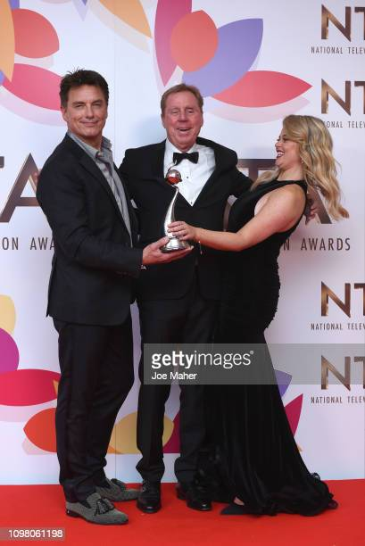 Harry Redknapp Emily Atack John Barrowman pose with The Bruce Forsyth Entertainment Award for I'm A Celebrity… Get Me Out Of Here in the winners room...