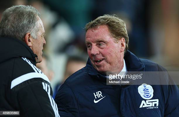 Harry Redknapp manager of QPR talks to Alan Curtis coach of Swansea City prior to the Barclays Premier League match between Swansea City and Queens...