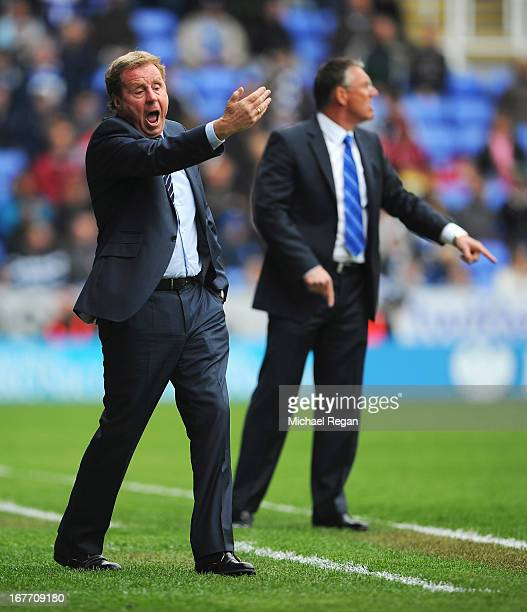 Harry Redknapp manager of Queens Park Rangers gives instructions with Nigel Adkins manager of Reading during the Barclays Premier League match...