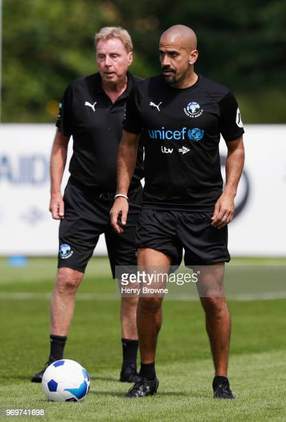 Harry Redknapp manager of the Rest of the World and Juan Sebastian Veron of the Rest of the World take part in training during Soccer Aid for UNICEF...