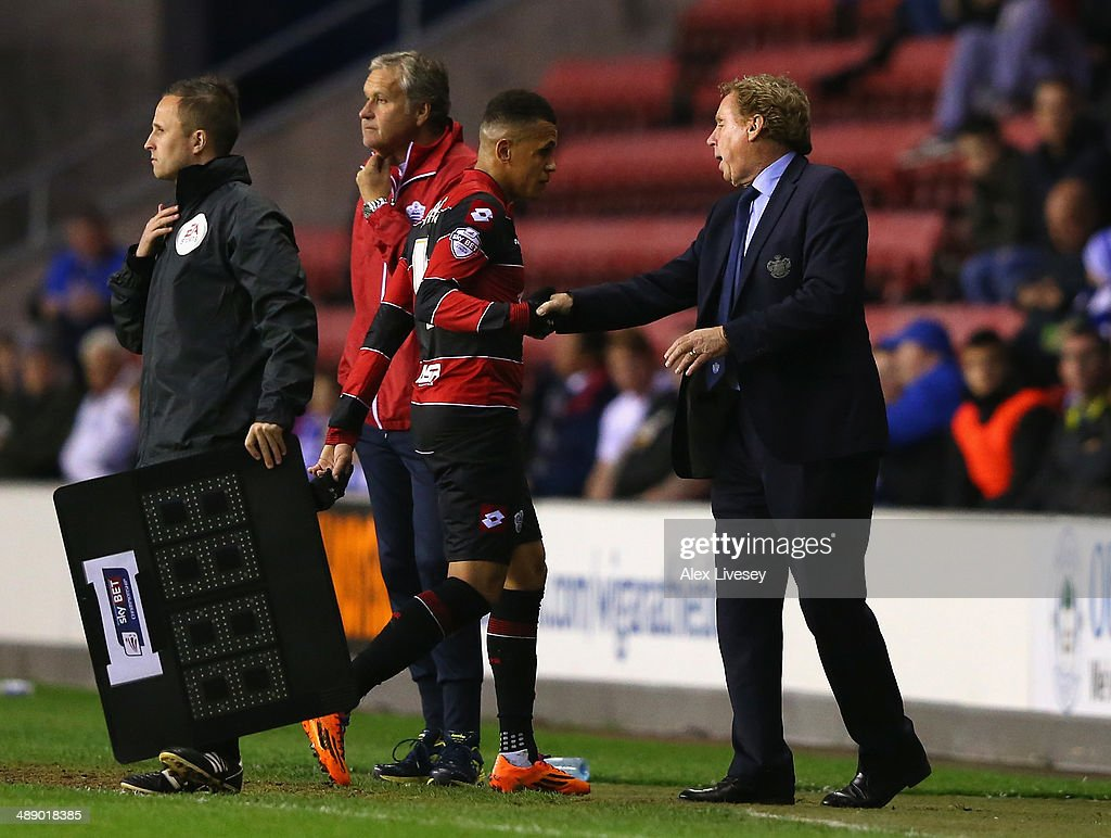 Harry Redknapp the manager of Queens Park Rangers talks with Ravel Morrison after substituting him during the Sky Bet Championship Play Off Semi Final first leg match between Wigan Athletic and Queens Park Rangers at DW Stadium on May 9, 2014 in Wigan, England.