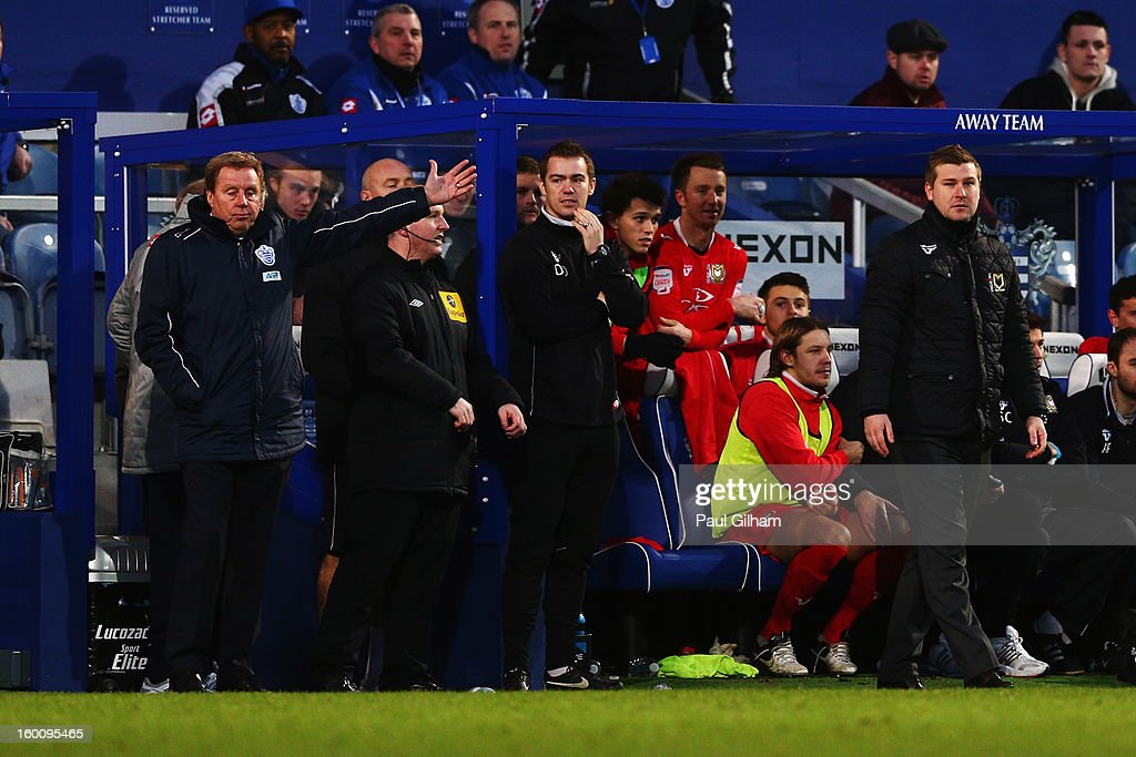 Harry Redknapp (L) the Queens Park Rangers manager and Karl Robinson (R) the Milton Keynes Dons manager react on the touchline during the FA Cup with Budweiser Fourth Round match between Queens Park Rangers and Milton Keynes Dons at Loftus Road on January 26, 2013 in London, England.