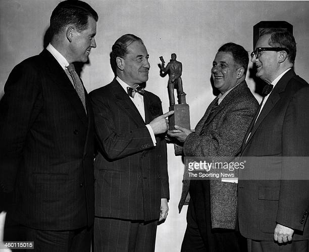 Harry Rosin Philadelphia sculptor who has been commissioned to create the Connie Mack Memorial shows model of proposed statue to David Gwinn a member...