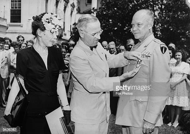 Harry S Truman, President of the United States, presenting the Distinguished Service Medal to General Dwight D Eisenhower on the lawn of the White...