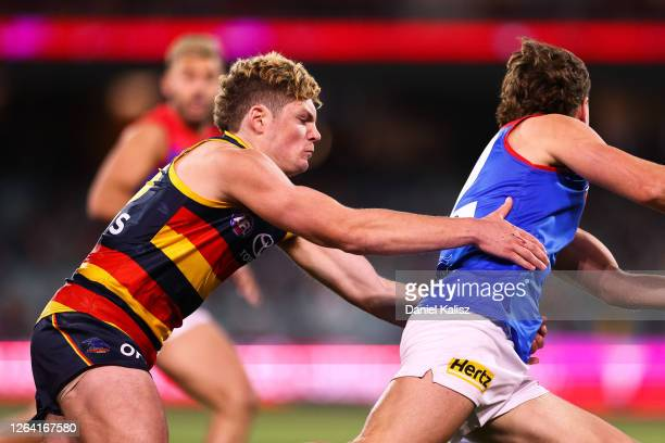 Harry Schoenberg of the Crows tackles during the round 10 AFL match between the Adelaide Crows and the Melbourne Demons at Adelaide Oval on August 05...