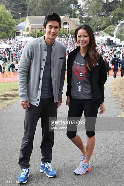 Harry Shum Jr and Jamie Chung pose at AIDS Walk San Francisco on July 15 2012 in San Francisco California