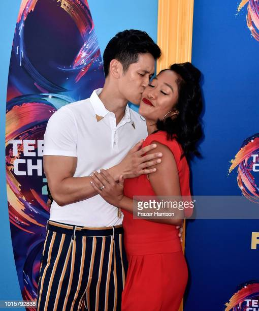 Harry Shum Jr and Shelby Rabara kiss during FOX's Teen Choice Awards at The Forum on August 12 2018 in Inglewood California