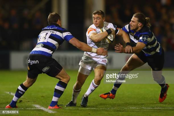 Harry Simmons of Leicester cuts between Jack Wilson and Max Clark of Bath during the AngloWelsh Cup Round 2 match between Bath Rugby and Leicester...