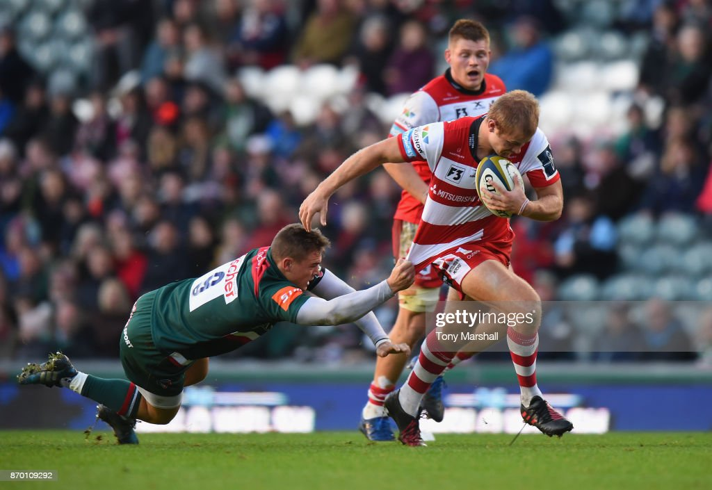 Harry Simmons of Leicester Tigers tackles Tom Hudson of Gloucester Rugby during the Anglo-Welsh Cup match at Welford Road on November 4, 2017 in Leicester, England.