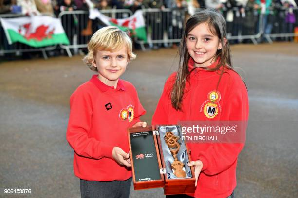 Harry Smith and Megan Taylor both from Marlborough Primary School with a wedding gift they plan to present to Britain's Prince Harry and his fiancée...