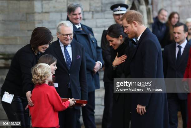 Harry Smith and Megan Taylor both from Marlborough Primary School presents Prince Harry and Meghan Markle with a wedding gift during a visit to...
