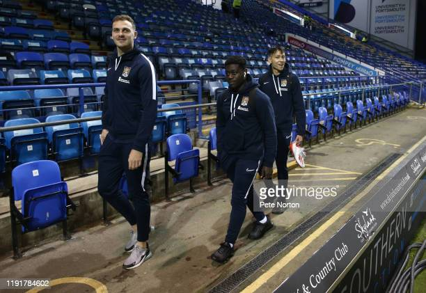 Harry Smith Michael Harding and Jacob Ballinger of Northampton Town walk to the dressing room prior to the Leasingcom Trophy match between Portsmouth...