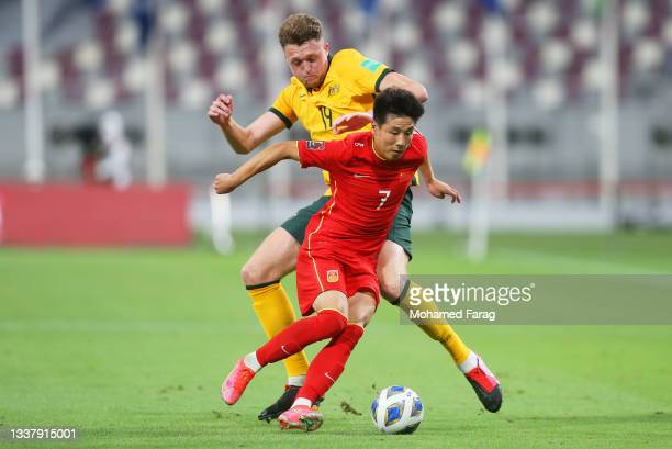 Harry Souttar of Australia and Wu Lei of China PR battle for the ball during the 2022 FIFA World Cup Qualifier match between Australia and China PR...