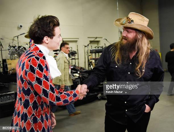 Harry Styles and Chris Stapleton attend the 2017 iHeartRadio Music Festival at TMobile Arena on September 22 2017 in Las Vegas Nevada