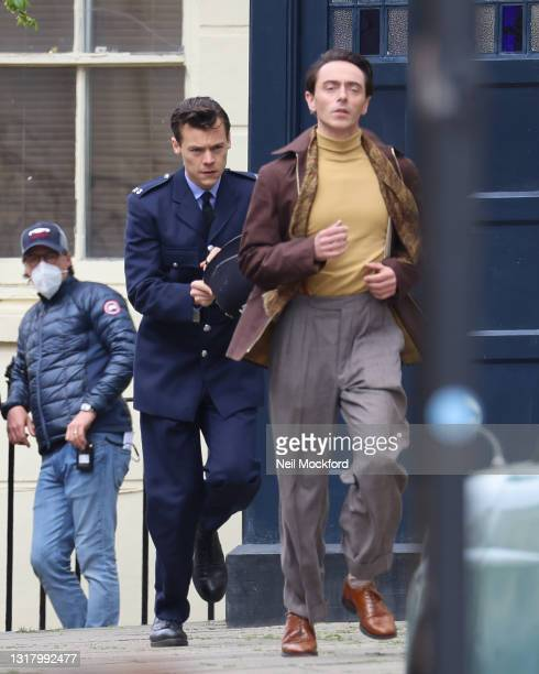 Harry Styles and David Dawson seen on the film set for 'My Policeman' on May 14, 2021 in Brighton, England.