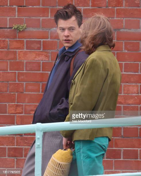 Harry Styles and Emma Corrin seen on the filmset for the 'My Policeman' on May 13, 2021 in Brighton, England.