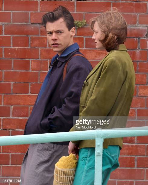 Harry Styles and Emma Corrin seen on the set for the 'My Policeman' on May 13, 2021 in Brighton, England.