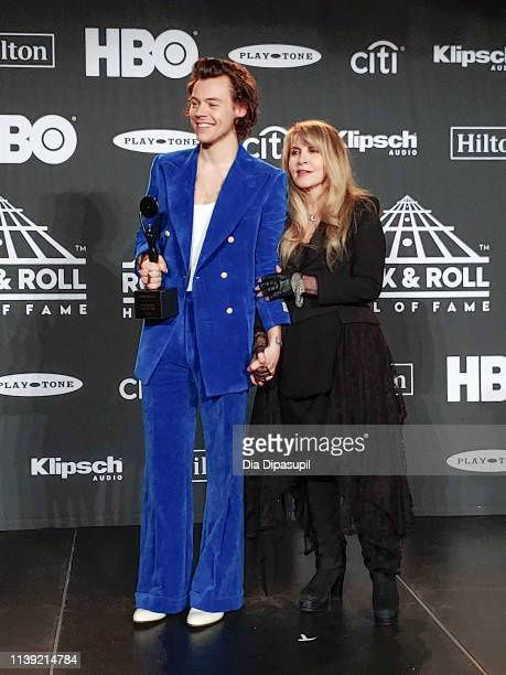 Harry Styles and inductee Stevie Nicks pose in the press room during the 2019 Rock & Roll Hall of Fame Induction Ceremony at Barclays Center on March...