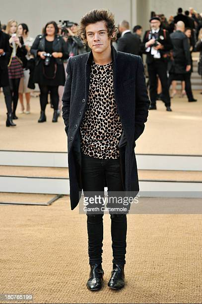 Harry Styles arrives at Burberry Prorsum Womenswear Spring/Summer 2014 show during London Fashion Week at Kensington Gardens on September 16 2013 in...