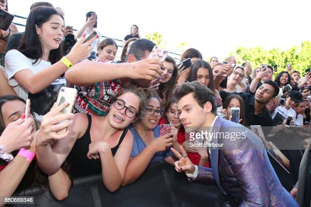 Harry Styles greets fanson the red carpet ahead of the 31st Annual ARIA Awards 2017 at The Star on November 28 2017 in Sydney Australia
